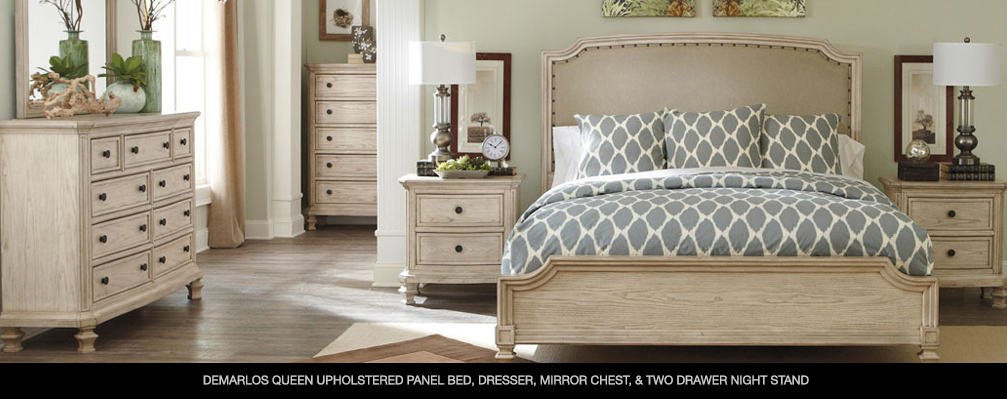 Demarlos Queen Upholstered Panel Bed, Dresser, Mirror Chest, & Two Drawer Night Stand