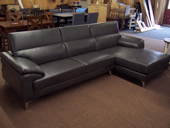Faux Leather Chaise Sofa. Was $1399.00,Ahner New Furniture